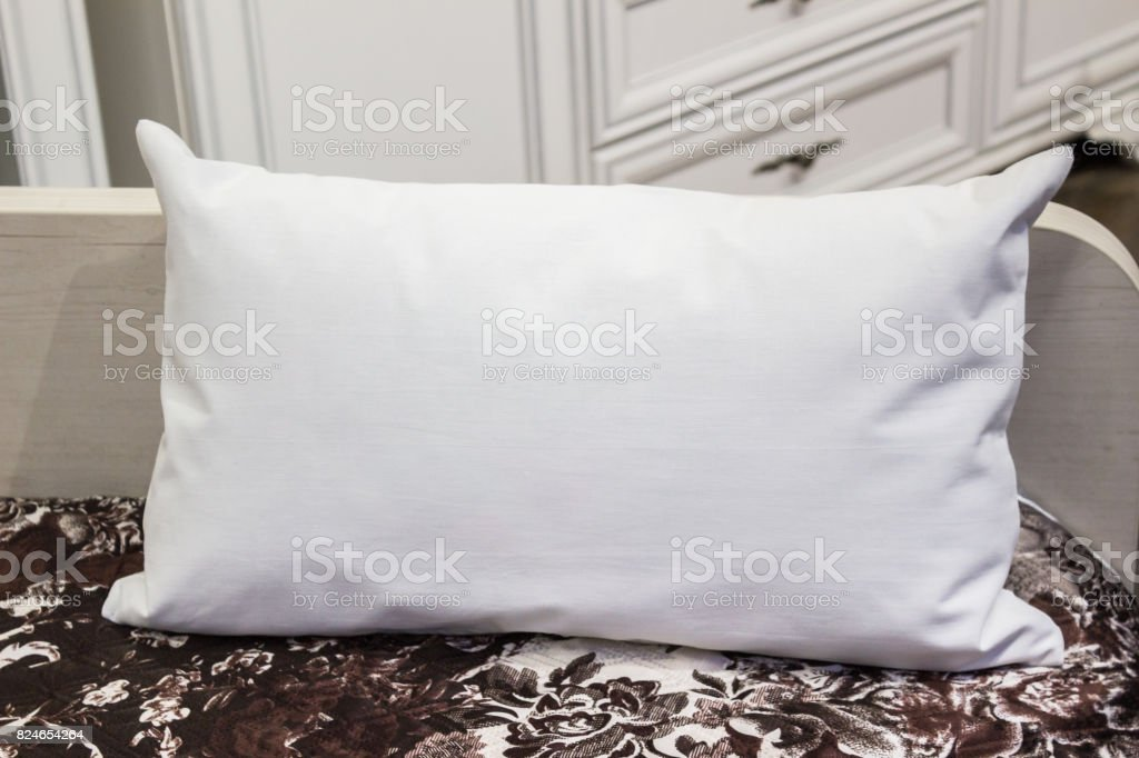 White lumbar pillow on a bed, case Mockup. Interior photo stock photo
