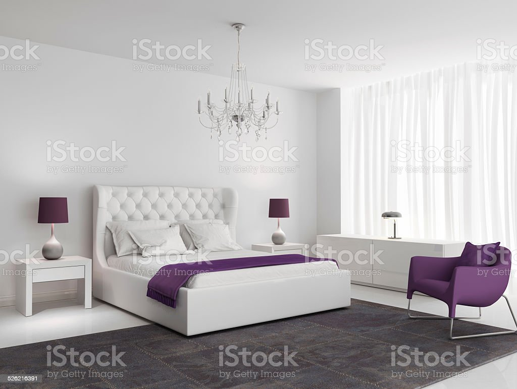 White luxury bedroom with purple armchair stock photo