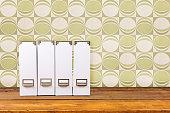 White magazine files on a wooden shelf