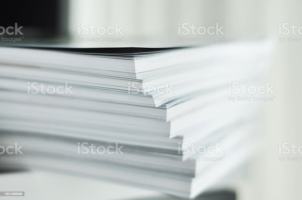 White magazine stacks close up stock photo