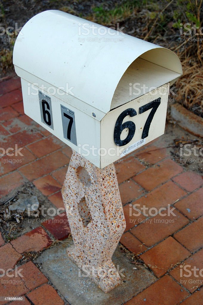 White mailbox with number stock photo