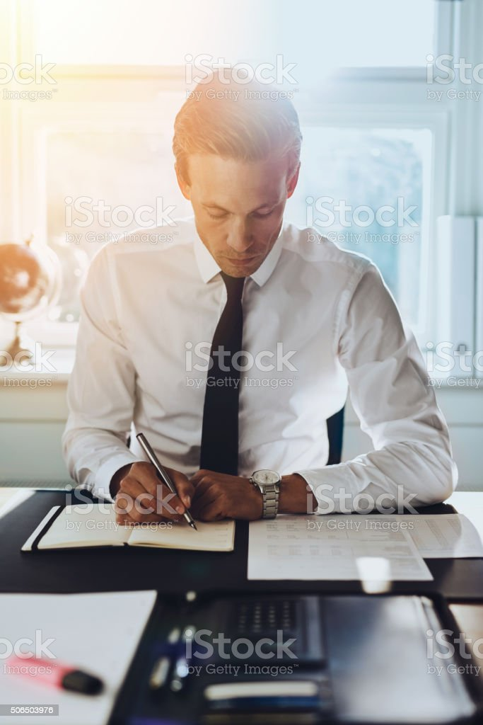 White male executive working at office stock photo