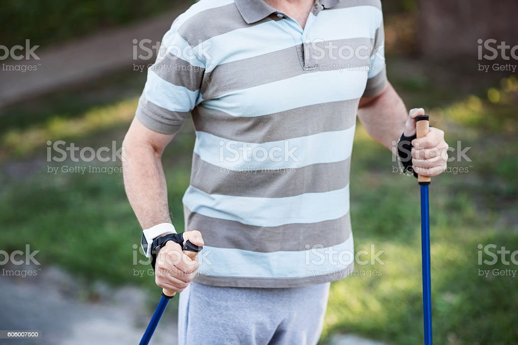 White male in stripped t-short practicing outside stock photo