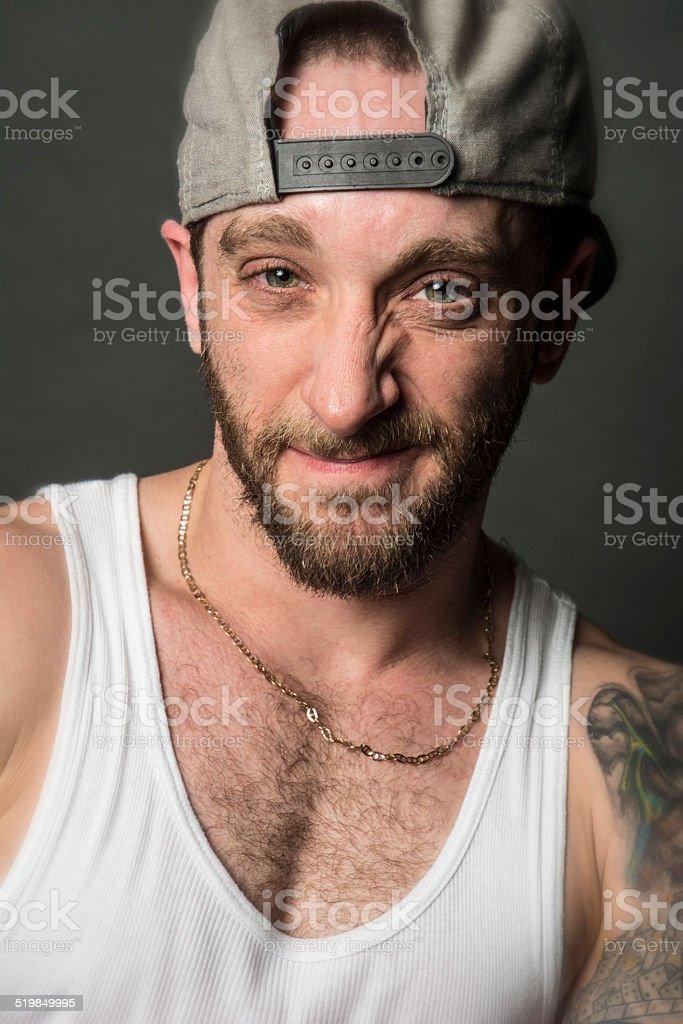 White Male Tattoo Hip Hop Style Rapper Headshot Sneering stock photo