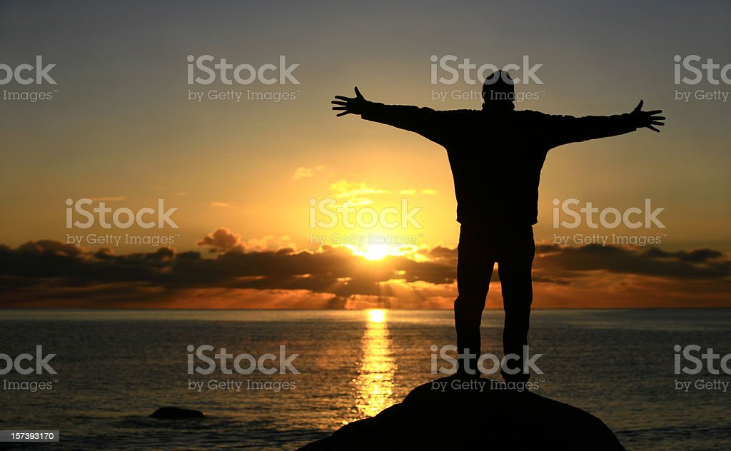 White Male With Arms Outstreched by the Sea royalty-free stock photo