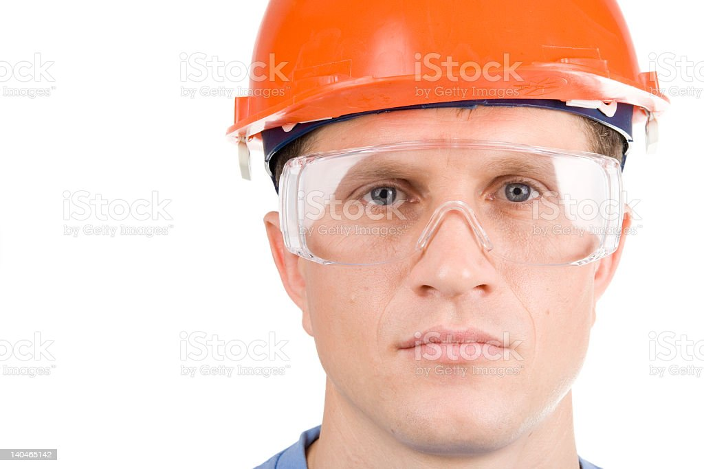White man looking directly at the camera wearing safety gear royalty-free stock photo