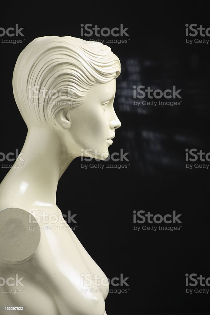 White manequin in profile on black background royalty-free stock photo