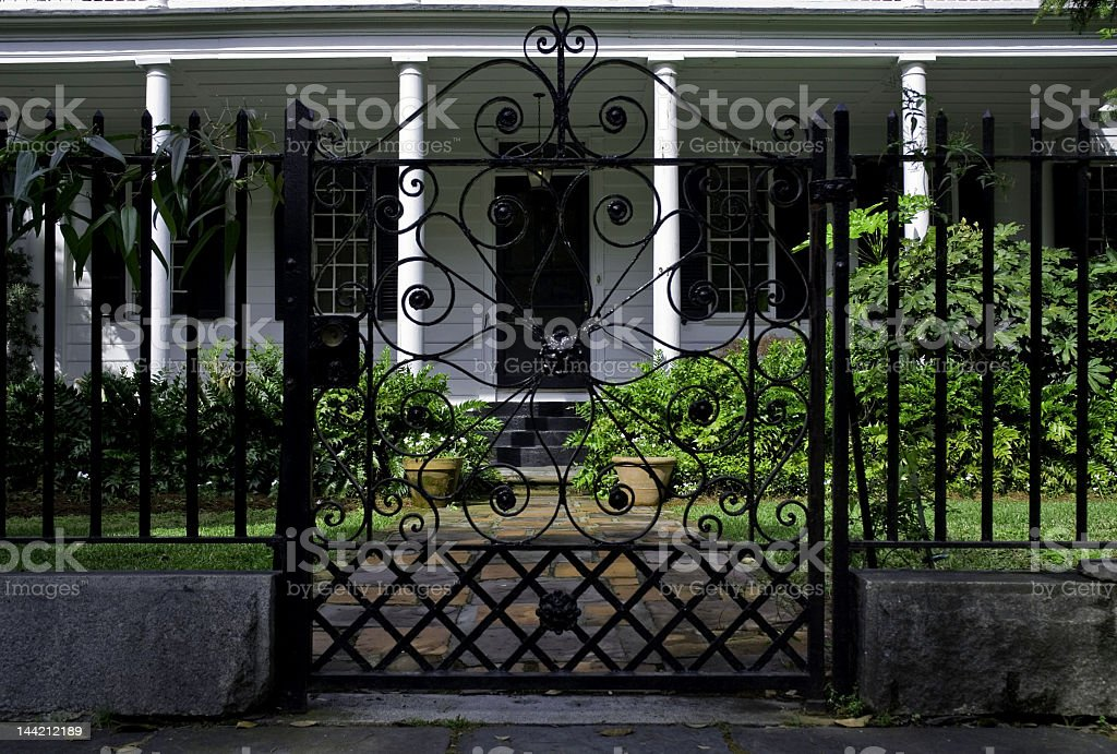 White Mansion Through a Wrought Iron Gate royalty-free stock photo