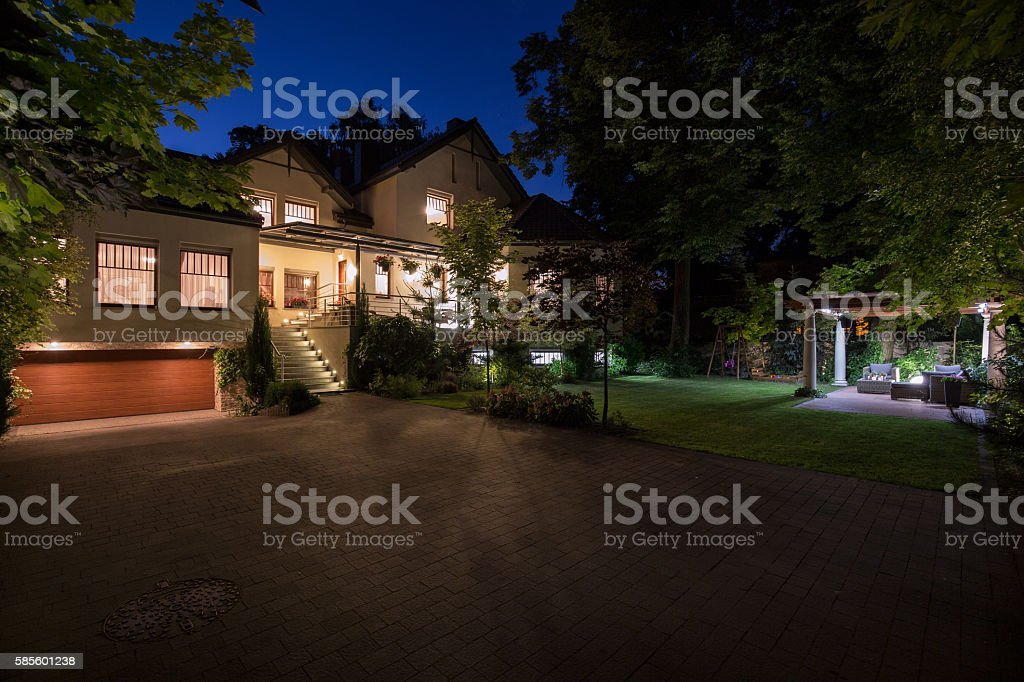 White mansion with cobbled driveway stock photo
