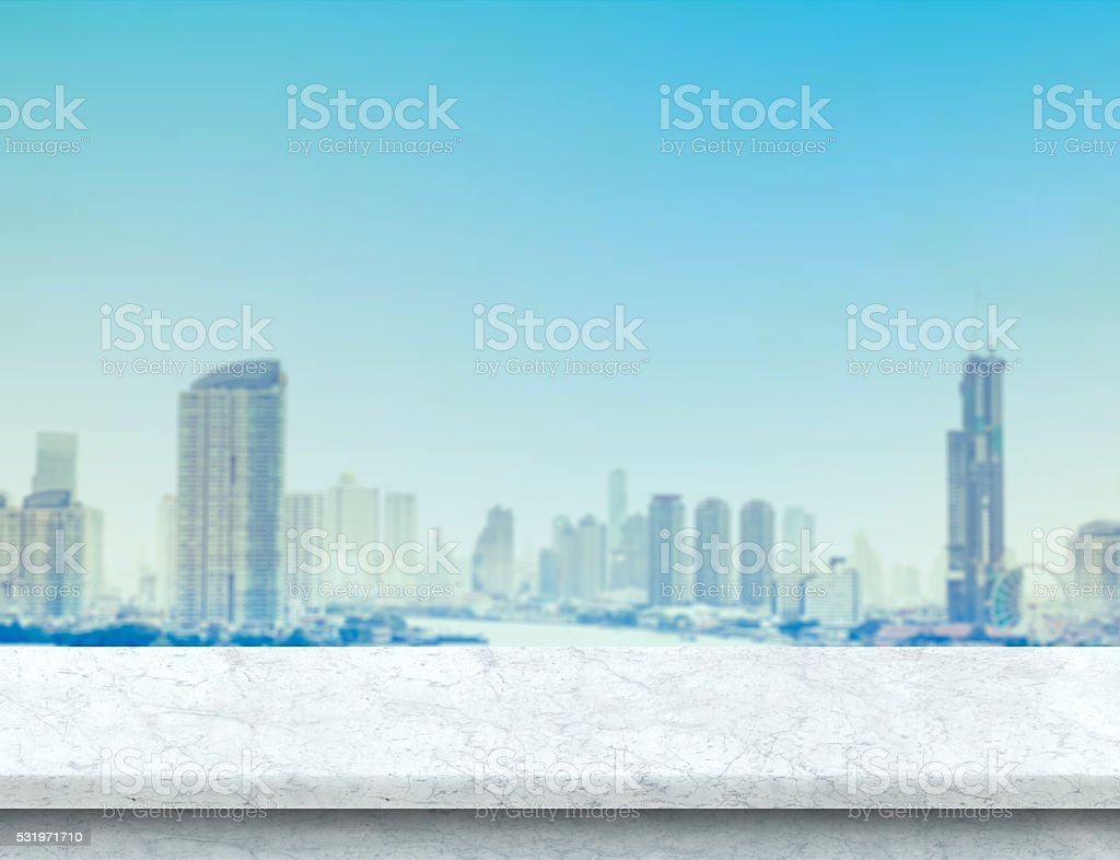 White marble table top with city building landscape view stock photo