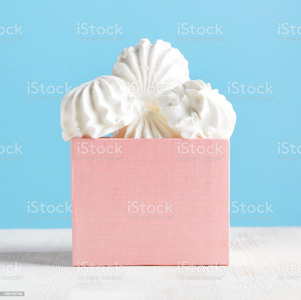 White marshmallow dessert in pink box stock photo