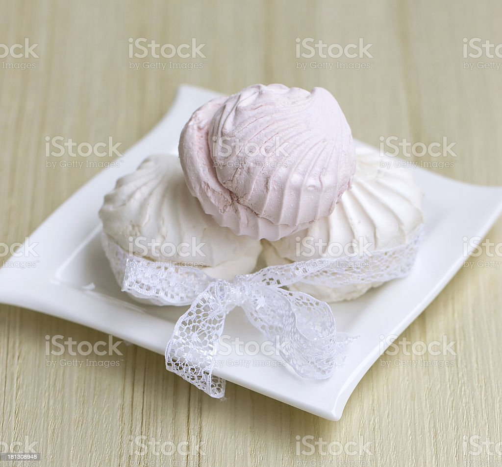 White marshmallow with a delicate lace stock photo