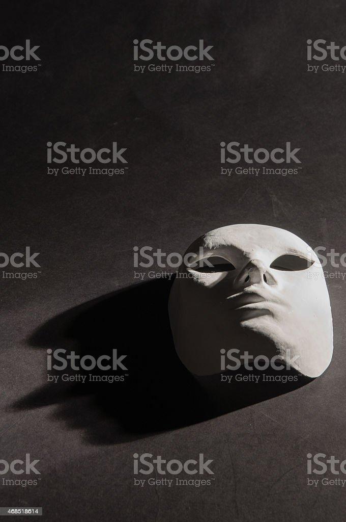 White mask shadow black background vertical stock photo