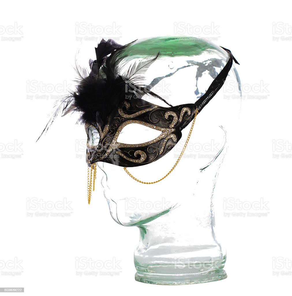 White Masquerade Mask on glass head stock photo