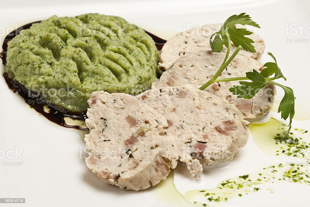 White meat roulade with mashed peas royalty-free stock photo