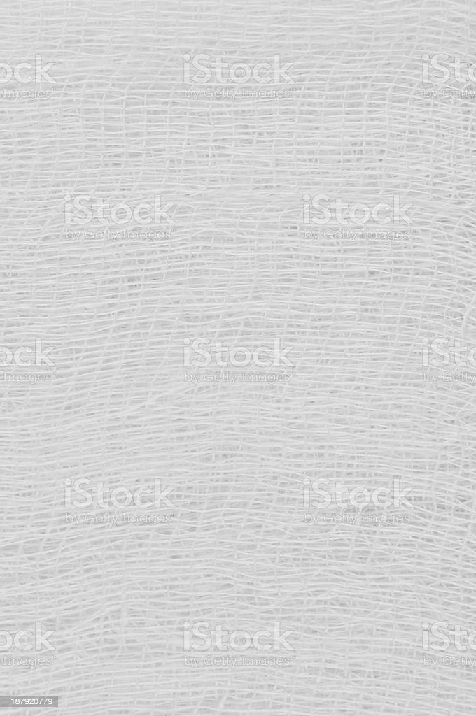 White medical bandage gauze texture, abstract textured background  macro closeup stock photo