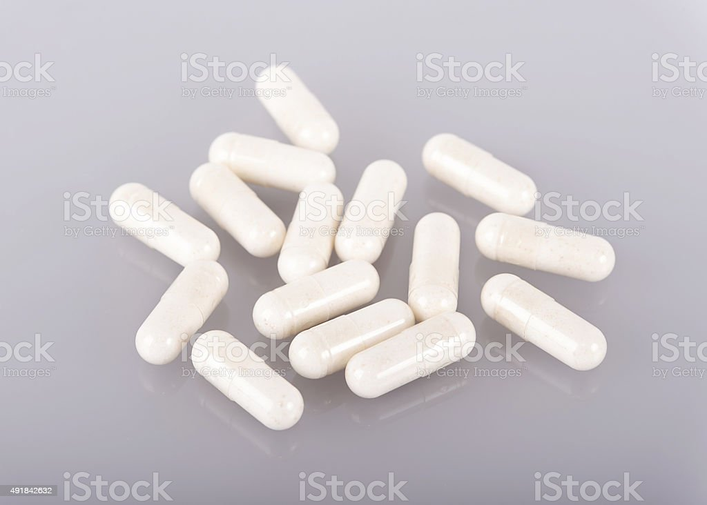 White medicine capsules stock photo