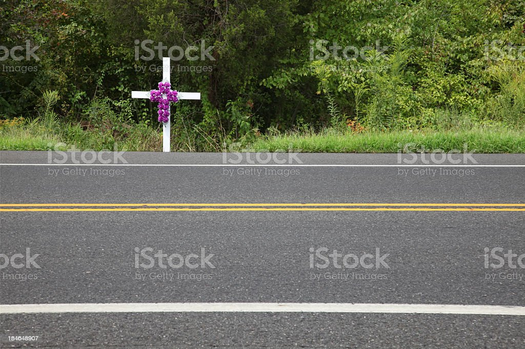 White memorial cross at the roadside stock photo
