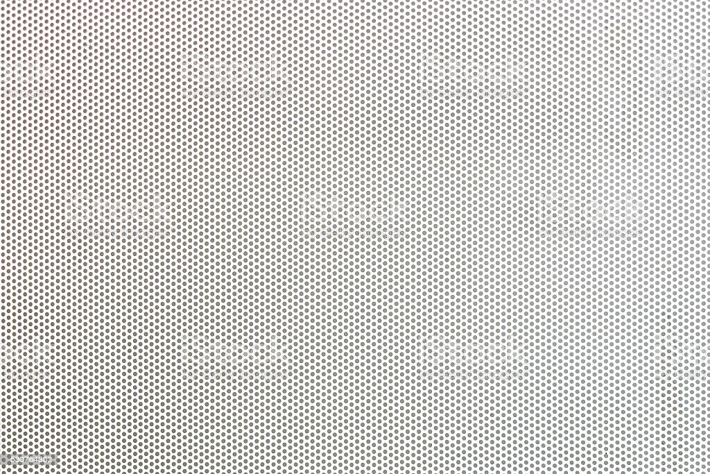 White metal plate with many small holes. stock photo