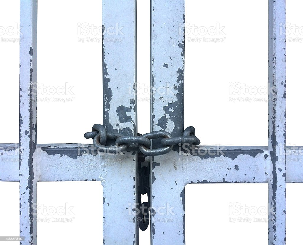 White metal prison bars with chain and chipped paint stock photo