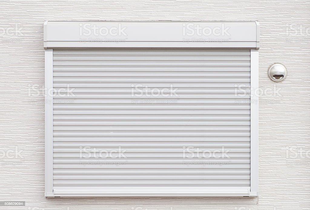 White metal roller door shutter background and texture stock photo