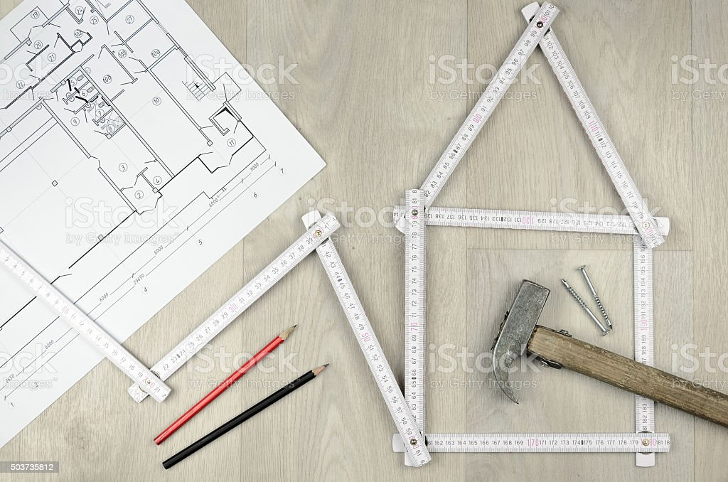 white meter tool forming a house and engineering tools stock photo