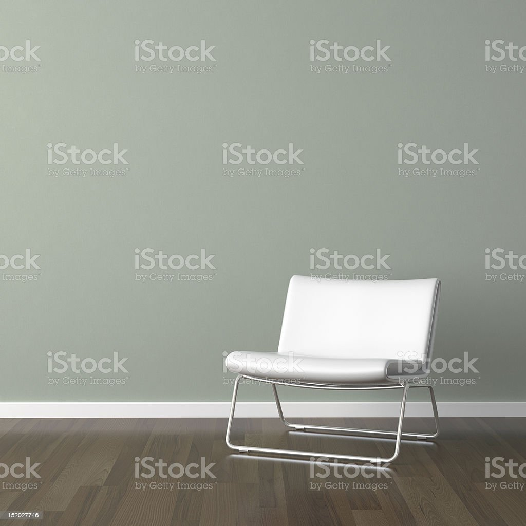 white modern chair on green wall royalty-free stock photo