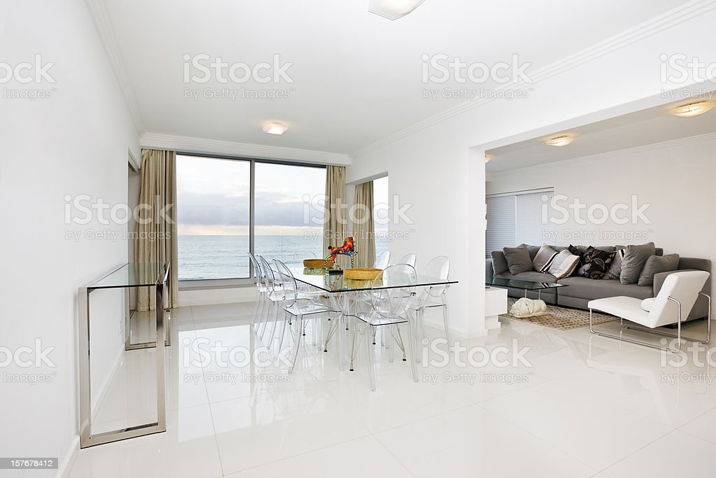 White modern dining room and lounge with a scenic view stock photo