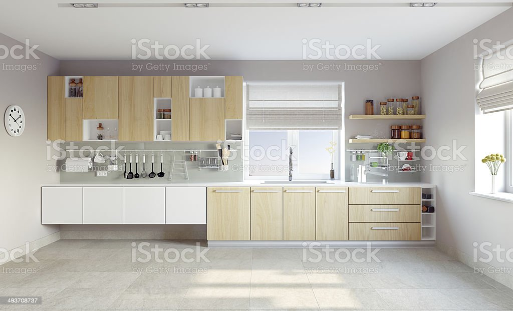 White modern kitchen with light brown cabinets stock photo