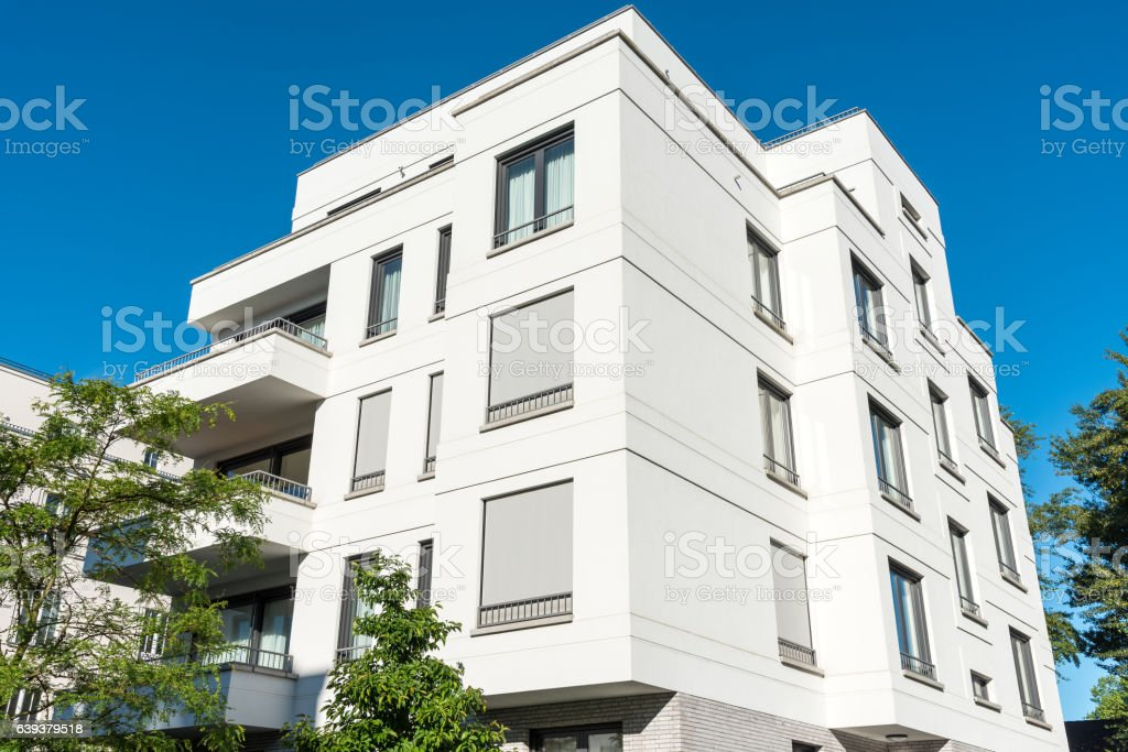 White modern multi-family house stock photo