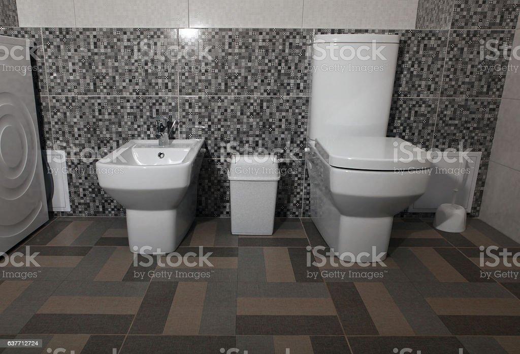 white modern toilet and bidet stock photo