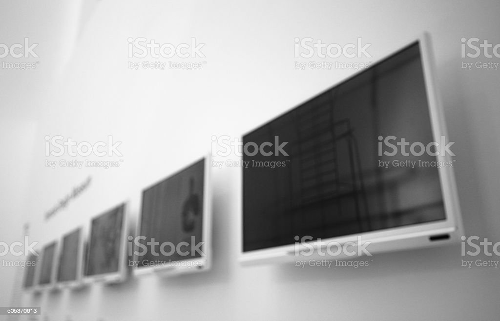 White monitor on a wall stock photo