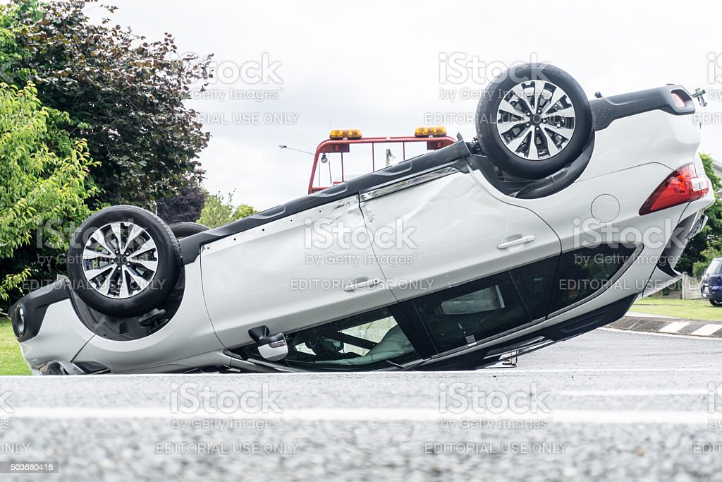 White motor vehicle on its roof stock photo