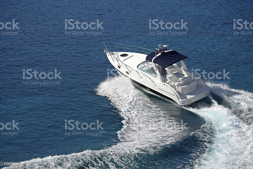 White motorboat making waves on blue water stock photo