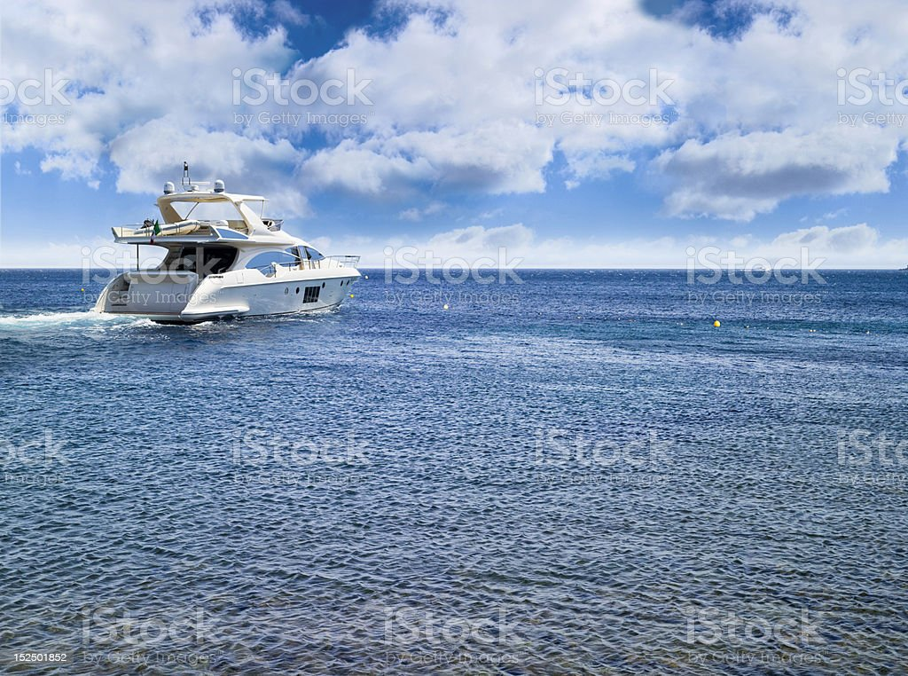 A white motorboat out on the sea on a very beautiful day  stock photo