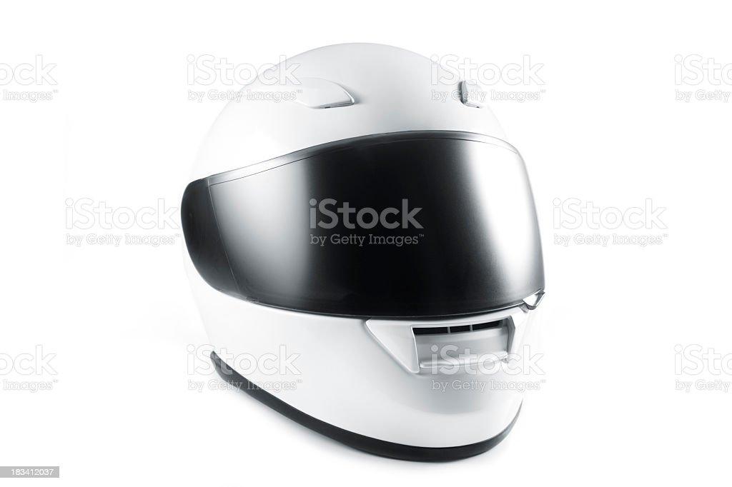 White motorcycle helmet with black visor on white background stock photo