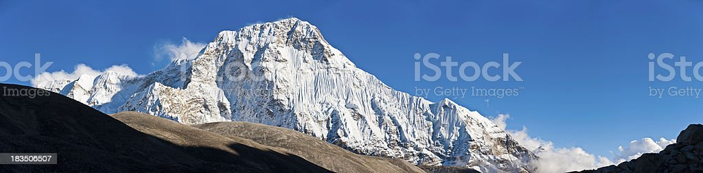 White mountain summit snowy glaciers dramatic high altitude wilderness panorama stock photo