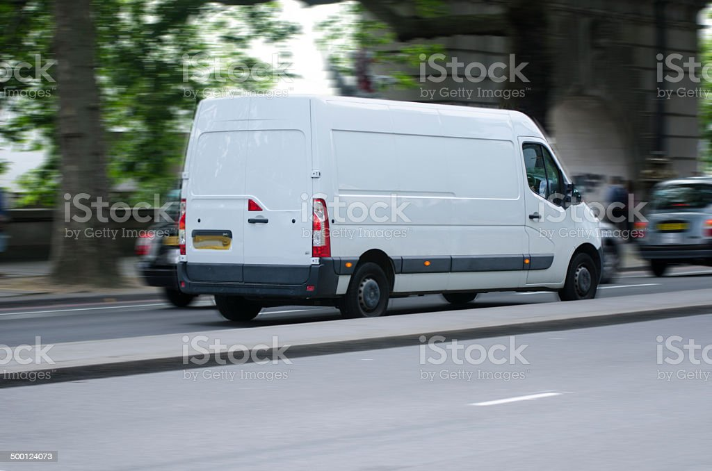 white moving van with blurred motion on the road stock photo
