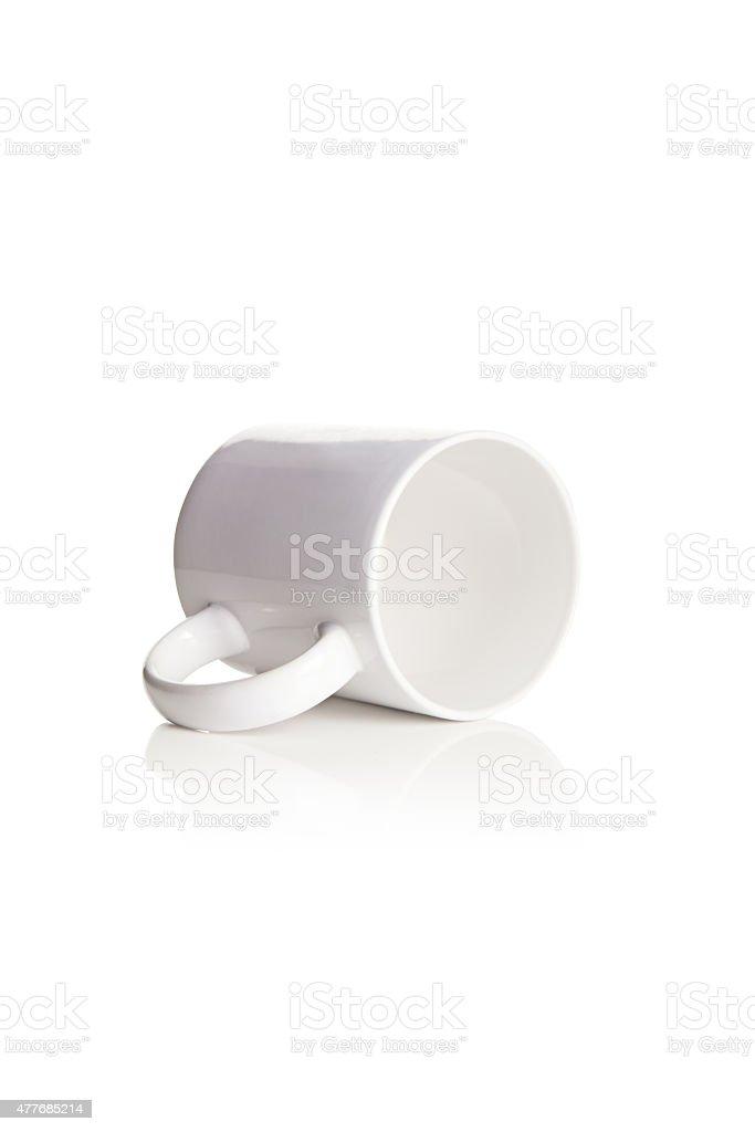 Tazza bianca tazza sul lato è foto stock royalty-free