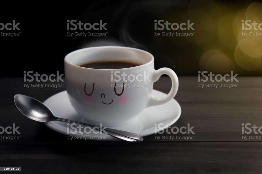 White mug of coffee with a happy smile, On bokeh background, Good night or Have a happy day concept stock photo