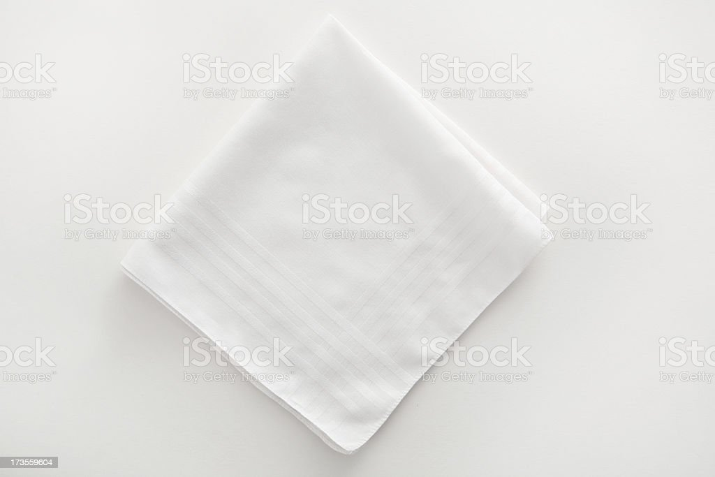 White napkin cloth on white background stock photo