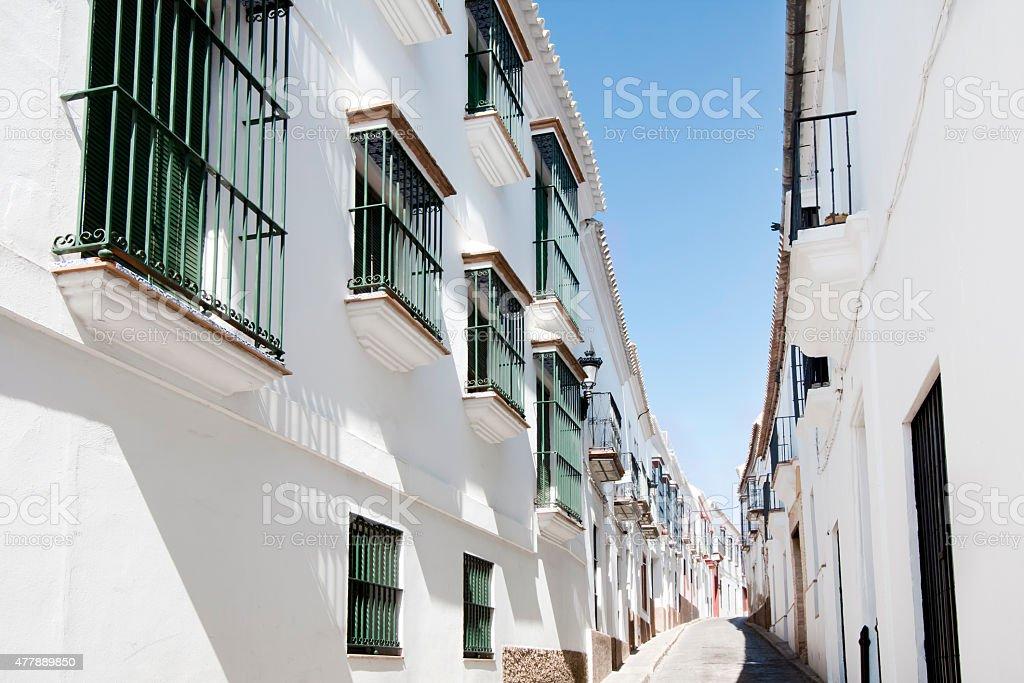 White narrow street in Carmona, Seville province, Spain. stock photo