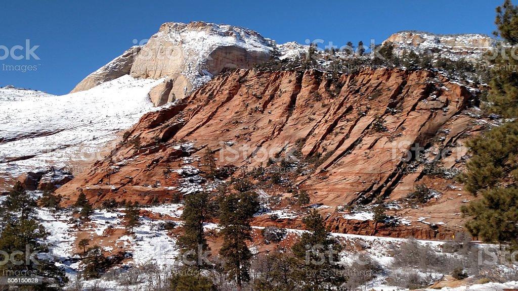 White Navajo Sandstone under snow convoluted red rocks Utah stock photo