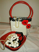 White necklace and little hand bag with poppies