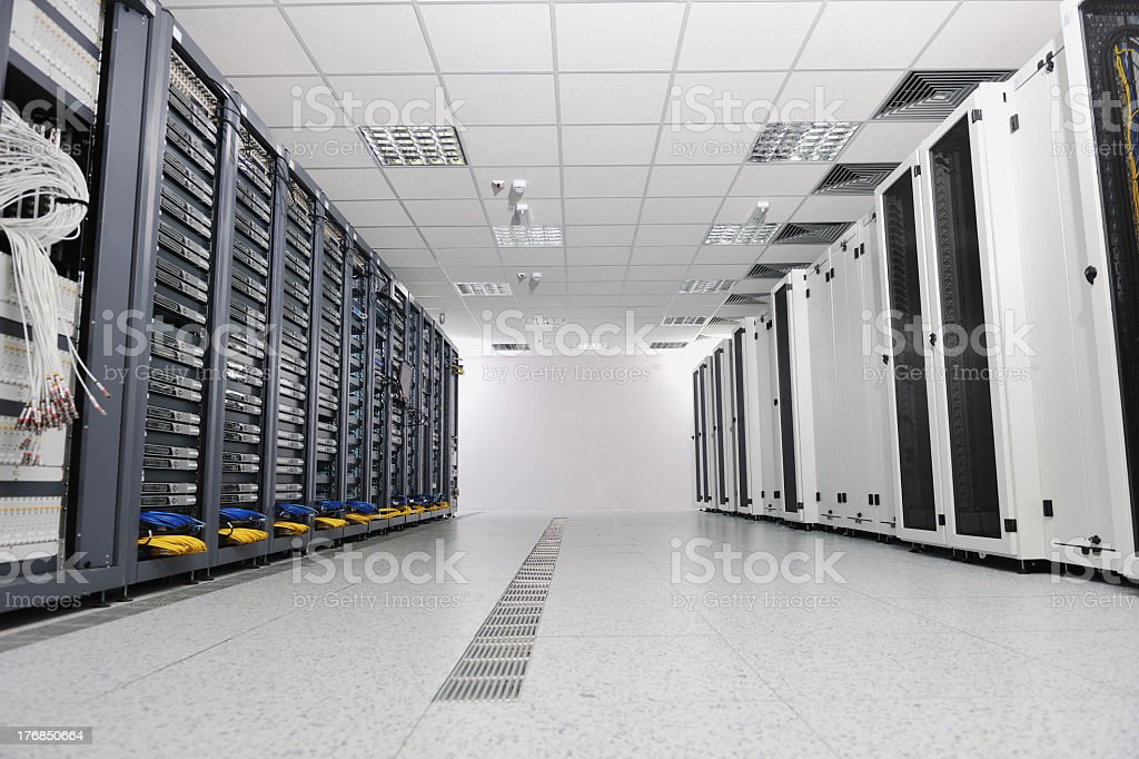 A white network server room with gray panels royalty-free stock photo