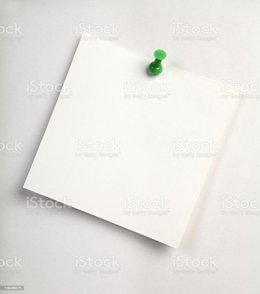 white note and green pin stock photo