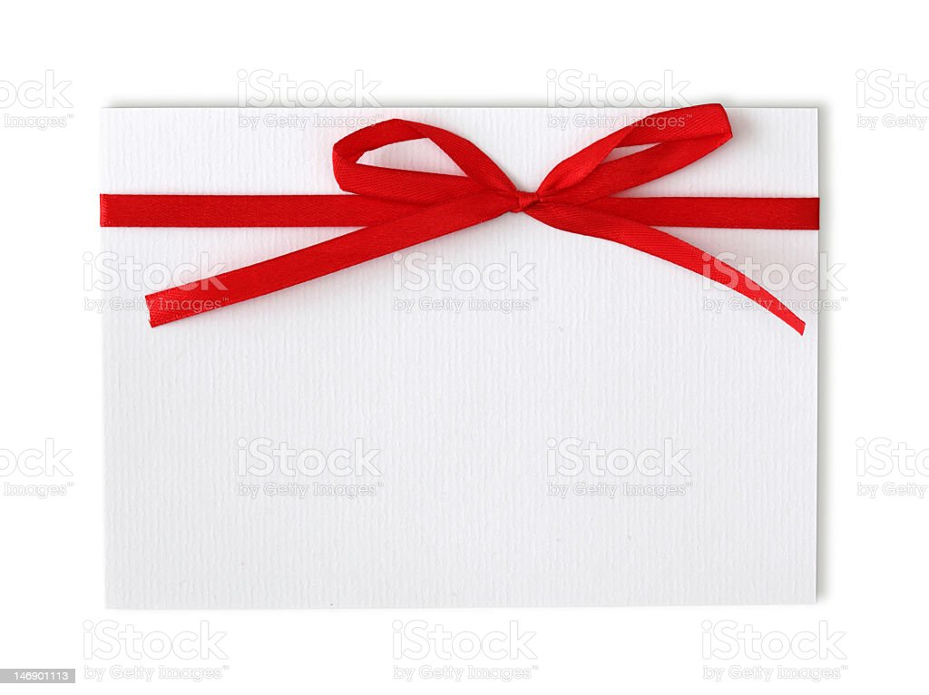 White note with a large red ribbon on it royalty-free stock photo