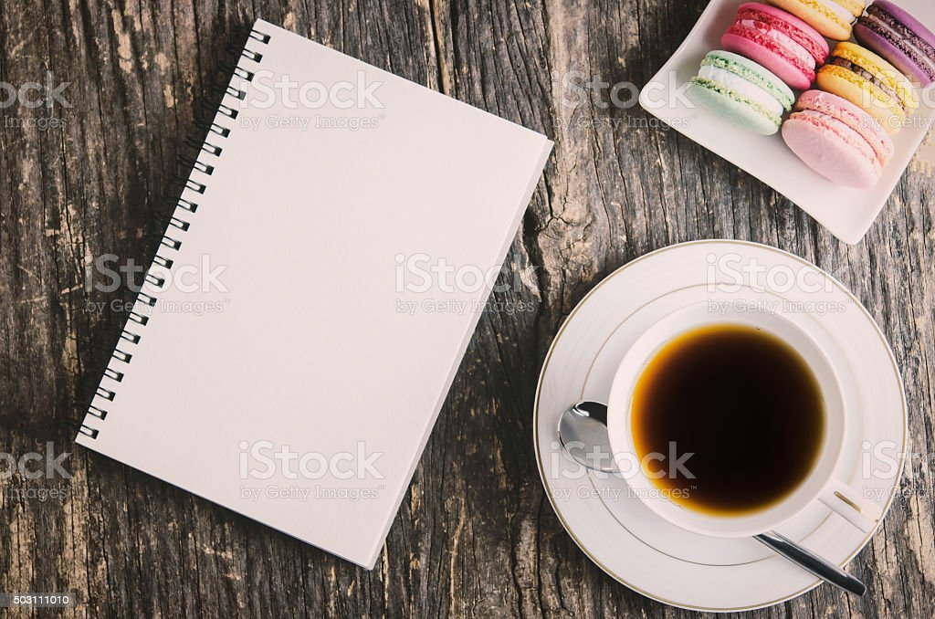 White notebook and cup of tea stock photo