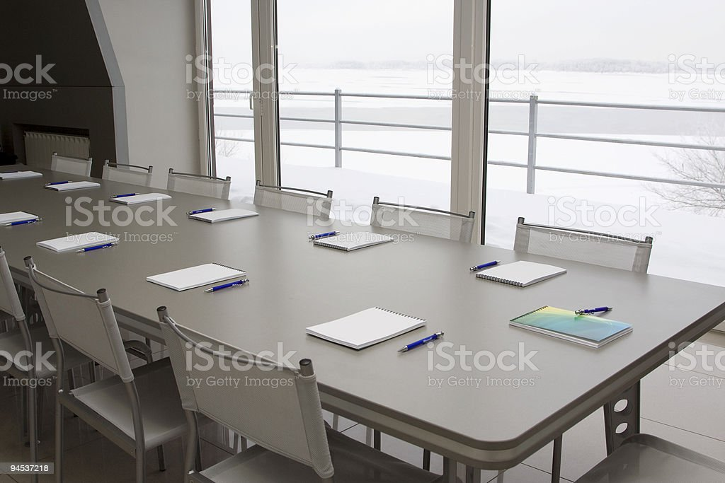 White notebooks laying on a grey table for negotions royalty-free stock photo