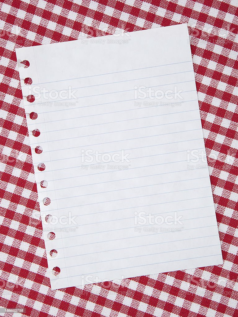 White notepad paper on red tablecloth royalty-free stock photo